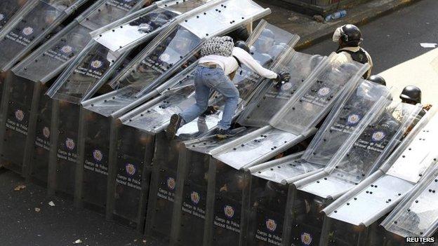 Venezuelan police attack protesters